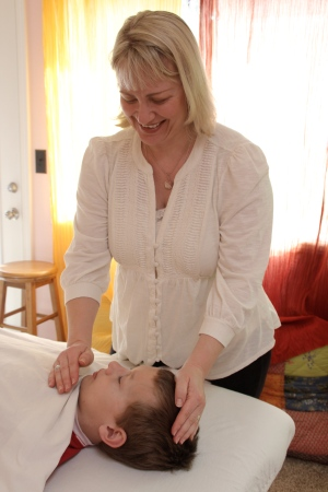 Me doing Reiki on my oldest son in the Rain Shadow Reiki room.  www.josslynstreett.com