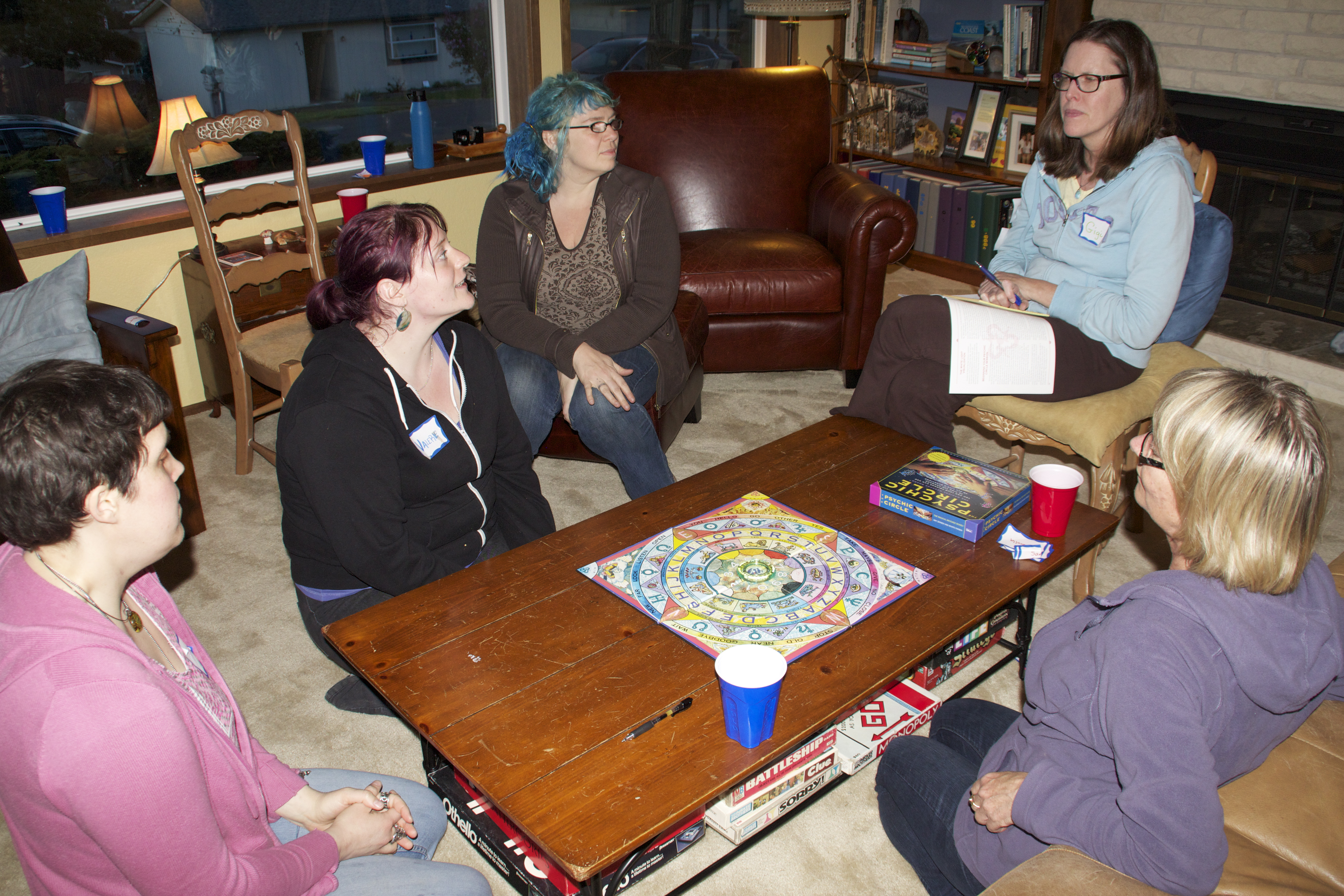 The Group In Living Room Learning How To Play Psychic Circle Game It
