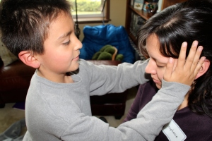 Jose practicing Reiki on his mom, Stephanie.